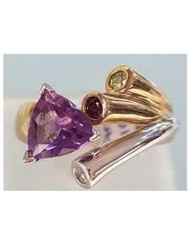 amethyst gold ring with three small gems