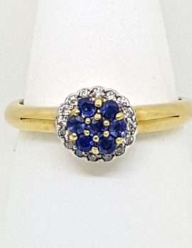 gold ring 9ct - floral cluster design - 7 blue sapphires & diamonds
