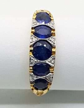 9ct gold ring 5 blue sapphires with diamonds in a Bridge setting