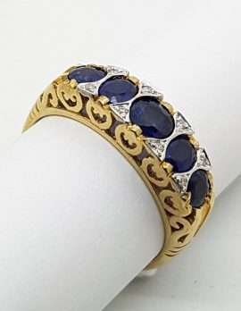 9ct gold ring 5 blue sapphires with diamonds.