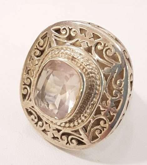 rose-quartz and decorative gold ring