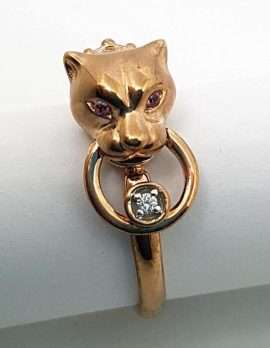 9ct Rose Gold Jaguar Head Ring with Pink Sapphire Eyes and Diamond in Ring