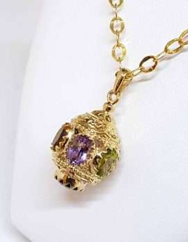 ornate gold spherical drop pendant with 3 gems amethyst citrine and peridot