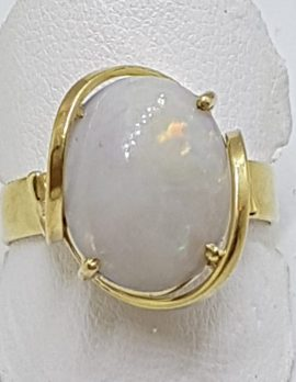 9ct Yellow Gold Oval Solid Opal Claw Set Ring