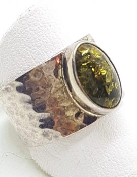 Sterling Silver Oval Green Amber Ring in Wide Beaten Design Band