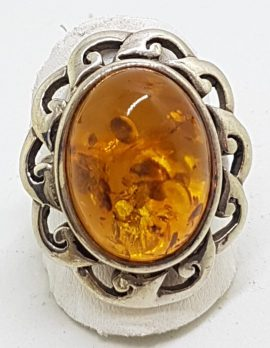 Sterling Silver Large Oval Natural Amber Ring with Twist Design