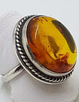 Sterling Silver Large Round Natural Amber Ring - With Twist Design Rim