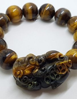 Large Carved and Round Tiger Eye Elastic Bead Bracelet