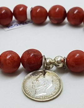 Sterling Silver Coral Bead Bracelet with Coin Charm