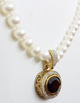 9ct Gold Oval Garnet surrounded by Diamonds Enhancer Pendant on Pearl Necklace
