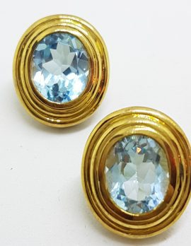 9ct Yellow Gold Large Oval Blue Topaz Stud Earrings