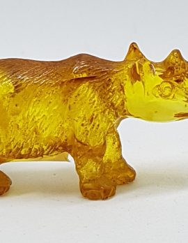 Hand Carved Natural Baltic Amber Small Rhinoceros Figurine / Statue