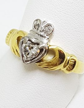 18ct Yellow and White Gold Irish Claddagh Ring set with a .25ct Heart Shaped Diamond Plus 2 Diamonds set into the Crown