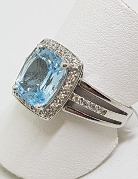 9ct White Gold Blue Topaz Surrounded by Diamonds Rectangular Cluster Ring