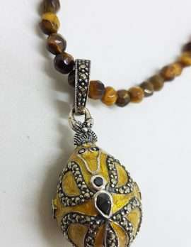 Sterling Silver Marcasite with Yellow Enamel Faberge Style Egg (which opens) Enhancer Pendant on Tiger Eye Bead Chain