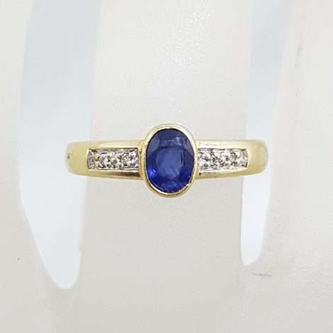 9ct Yellow Gold Oval Natural Blue Sapphire and Diamond Bezel Set Ring