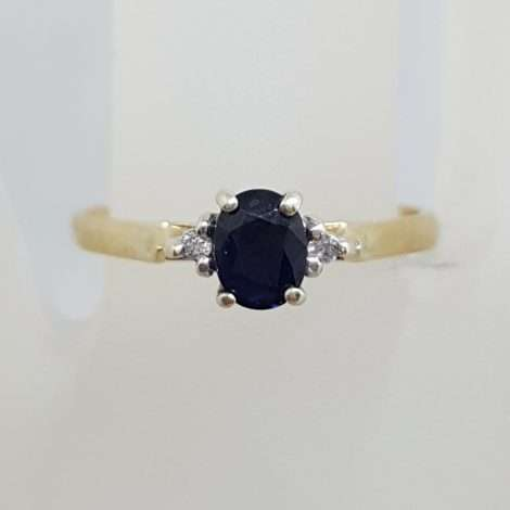 9ct Yellow Gold Oval Natural Blue Sapphire with Two Diamond Ring