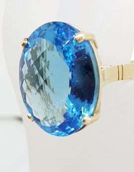 9ct Yellow Gold Large Oval Deep Blue Cushion Cut Topaz Claw Set Cocktail Ring