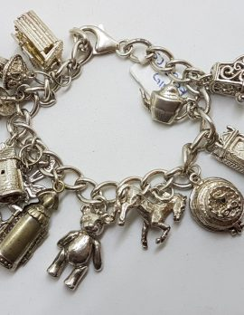 Sterling Silver Heavy Vintage Charm Bracelet with Assorted Charms Including Jointed Teddy Bear