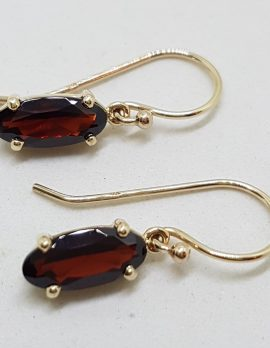 9ct Yellow Gold Elongated Oval Garnet Claw Set Drop Earrings