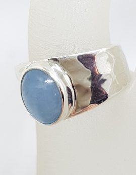 Sterling Silver Oval Bezel Set on Wide Beaten Design Band Cabochon Cut Aquamarine Ring