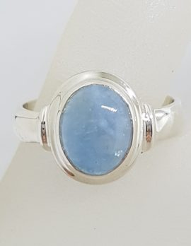 Sterling Silver Oval Bezel Set with Rim Cabochon Cut Aquamarine Ring
