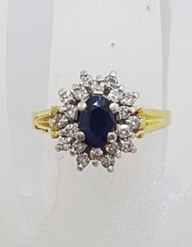 9ct Yellow Gold Oval Natural Sapphire surrounded by Diamond Cluster Ring