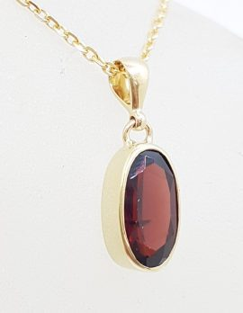 9ct Yellow Gold Oval Bezel Set Garnet Pendant on Gold Chain