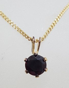 9ct Yellow Gold Round Claw Set Garnet Pendant on Gold Chain