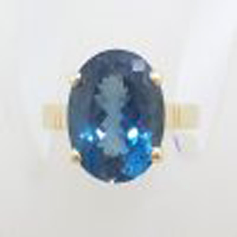 9ct Yellow Gold Oval Claw Set London Blue Topaz Ring