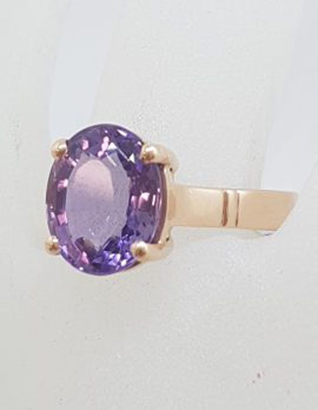 9ct Rose Gold Oval Claw Set Amethyst Ring