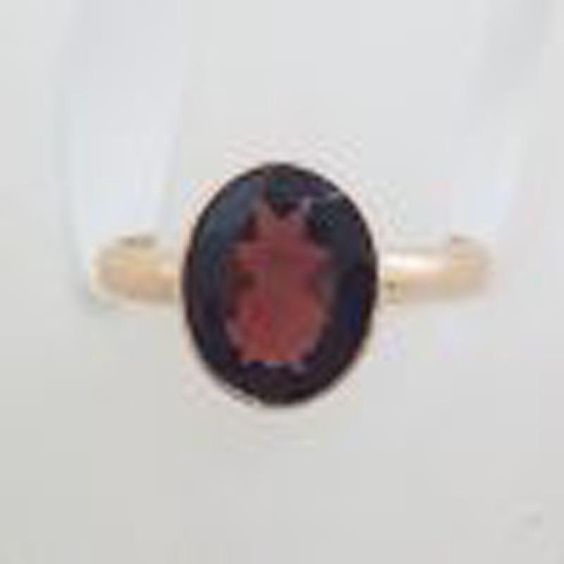 9ct Rose Gold Oval Bezel Set Garnet Ring