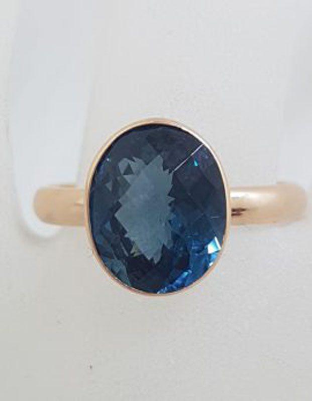 9ct Rose Gold Oval Bezel Set London Blue Topaz Ring