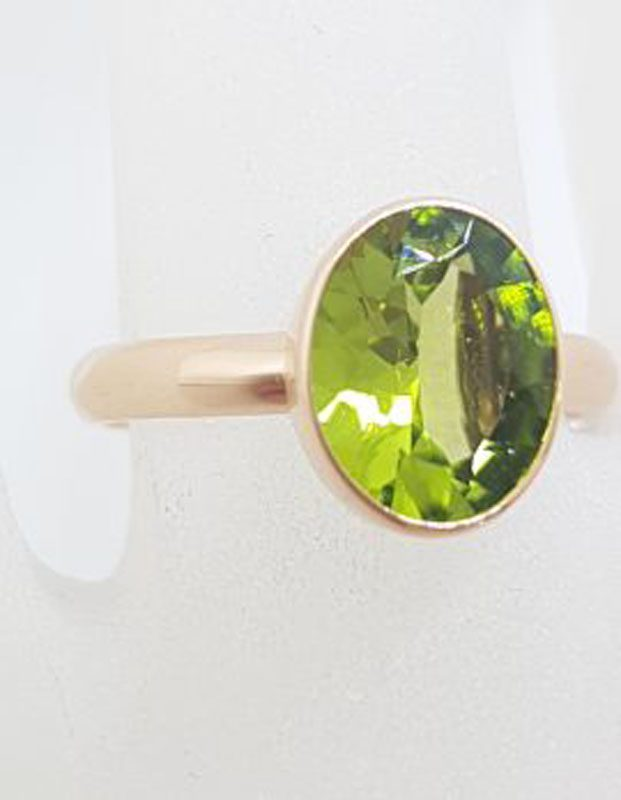 9ct Rose Gold Oval Bezel Set Peridot Ring