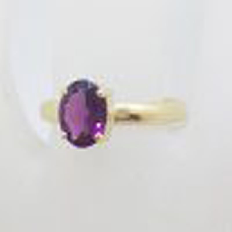 9ct Yellow Gold Oval Claw Set Rhodolite Garnet Ring