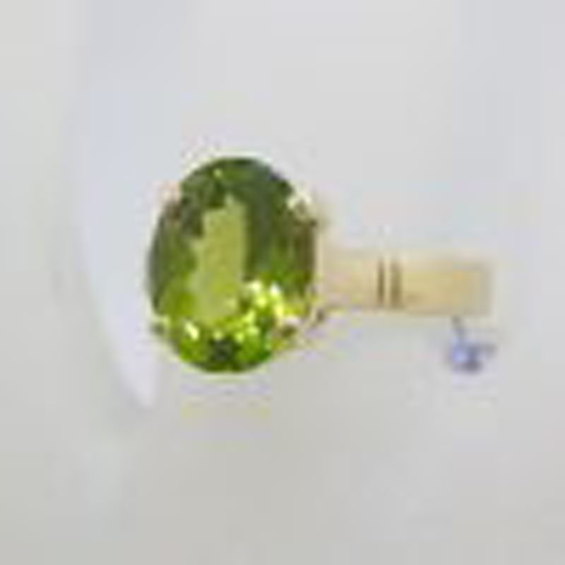 9ct Yellow Gold Oval Claw Set Peridot Ring