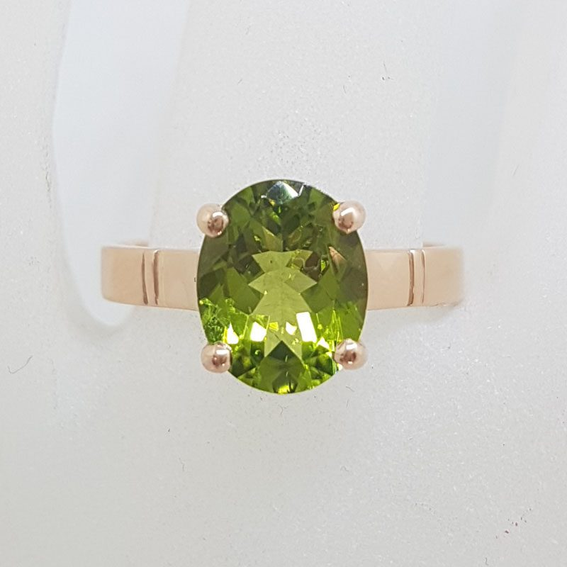 9ct Rose Gold Oval Claw Set Peridot Ring