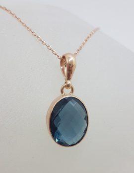 9ct Rose Gold Oval London Blue Topaz Bezel Set Pendant on Gold Chain