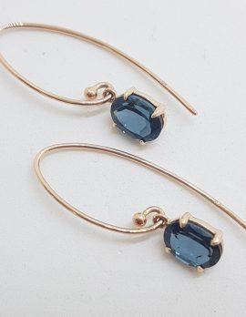 9ct Rose Gold Long Oval Claw Set London Blue Topaz Drop Earrings