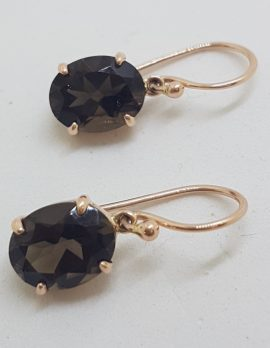 9ct Yellow Gold Oval Smokey Quartz Claw Set Drop Earrings