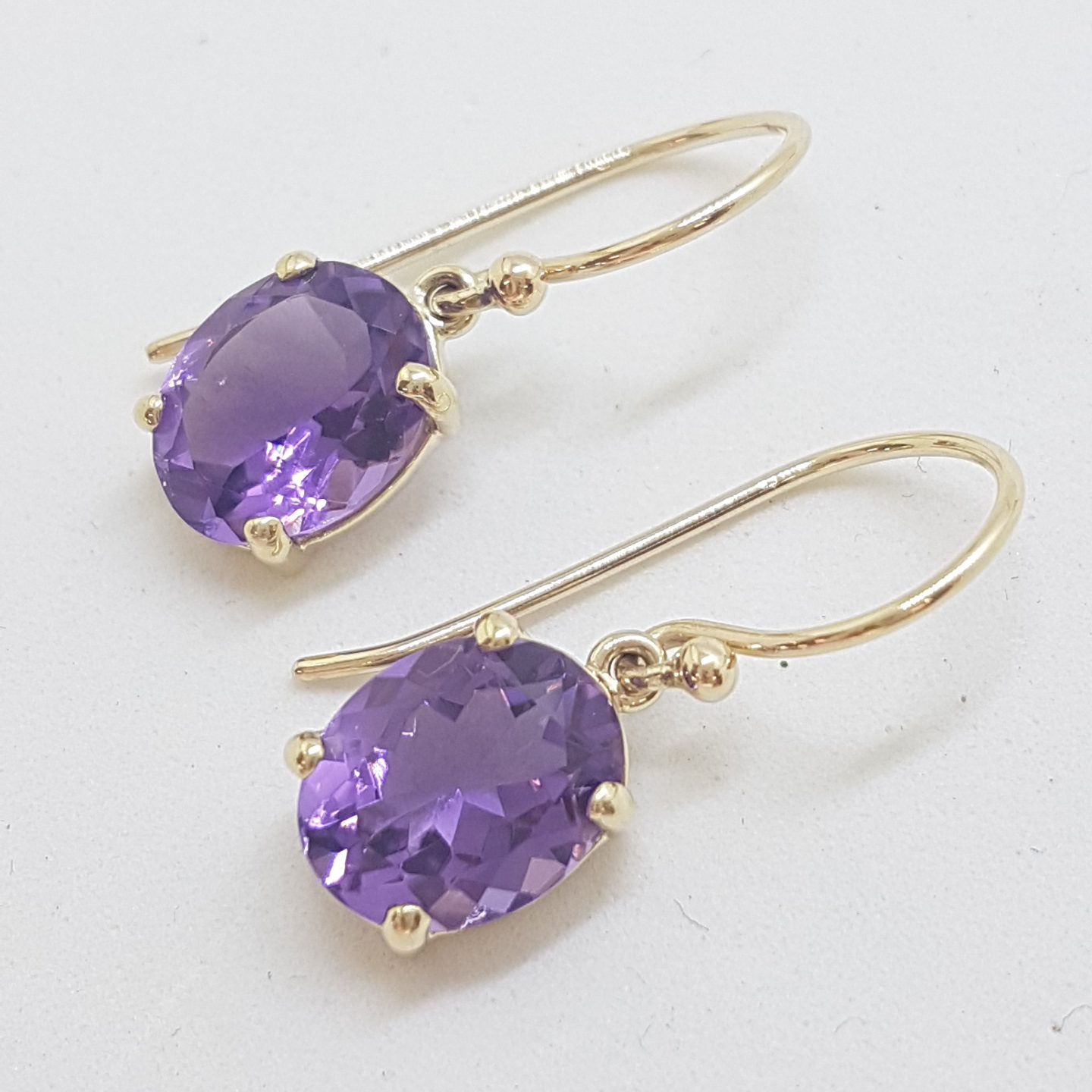 9ct Yellow Gold Oval Claw Set Amethyst Drop Earrings