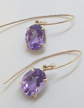 9ct Yellow Gold Oval Claw Set Long Amethyst Drop Earrings