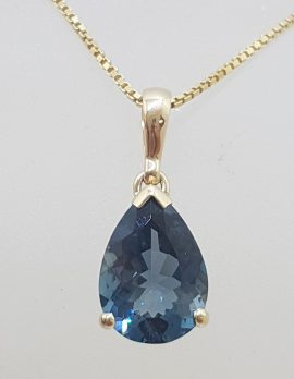 9ct Yellow Gold Teardrop / Pear Shape London Blue Topaz Claw Set Pendant on Gold Chain